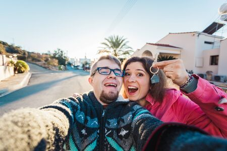 real estate: happy couple showing keys of their new house Stock Photo