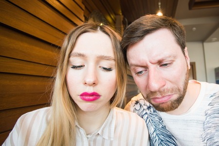 faithlessness: Portrait of unhappy young couple having problems. Stock Photo
