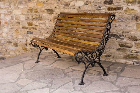 Stylish bench In the old stone town