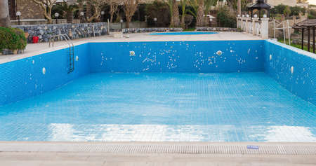 A swimming pool empties at the end of tourist season.