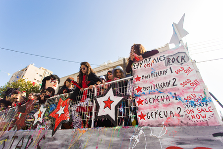 LIMASSOL, CYPRUS - FEBRUARY 26: Grand Carnival Parade - an unidentified people of all ages ,gender and nationality in colorful costumes during the street carnival, February 26, 2017 in Limassol, Cyprus Editorial