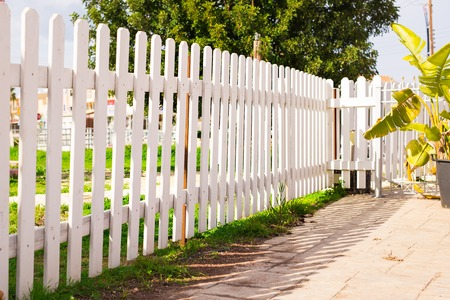 White fence in perspective Stock Photo