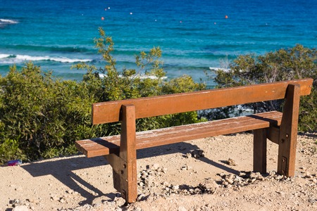 Wooden bench in front of the sea
