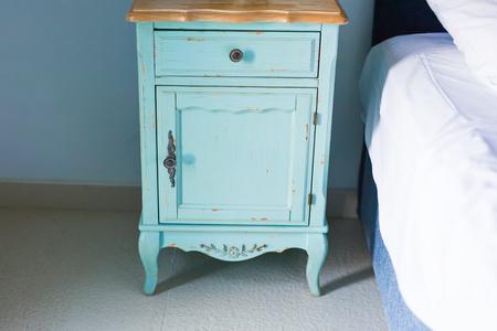 nightstand: Blue stylish nightstand Stock Photo