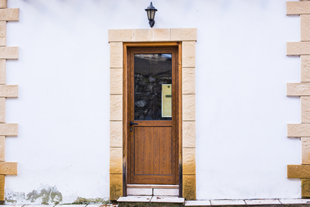 door knob: A front entrance of a home with a door