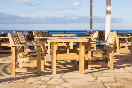 round chairs: Street cafe. Wooden outdoor restaurant
