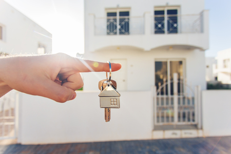key in hand for new home and real estate 免版税图像