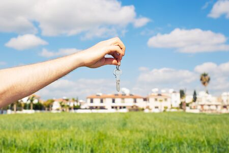 key in hand for new home and real estate Stock Photo