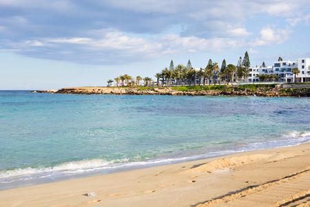 Travel, vacation, summer concept - Beautiful landscape beach, Cyprus island, Mediterranean Sea. Amazing blue sea and sunny day. Banco de Imagens