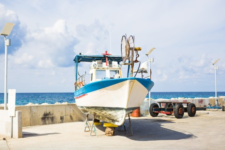 cruising: The yachts are aground in shallow sea water. Boat run aground in waterless pier or harbor.