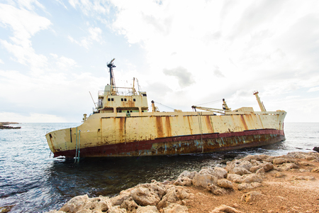 ship wreck: Ship wreck surrounded by sea waves on beach, Cyprus Stock Photo