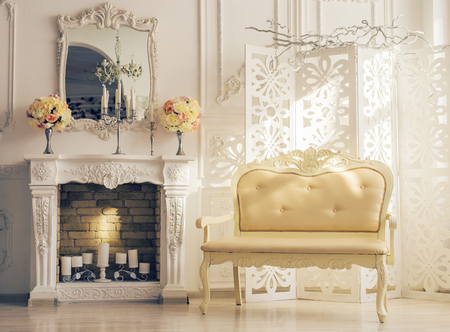 luxury living room: Classic white Interior Of Living Room With Sofa Near Fireplace