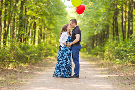 Caucasian pregnant woman and her husband outdoors