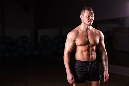 sixpack: Strong Athletic Man Fitness Model Torso showing six pack abs