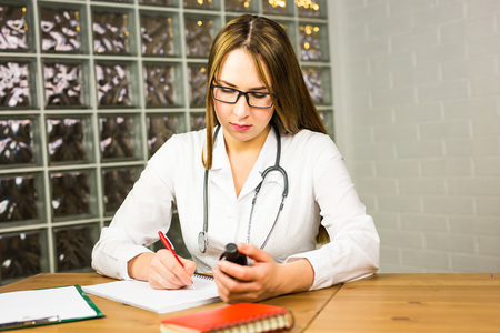 prescription pad: Doctor writing prescription and holding bottle with pills. Healthcare, medical and pharmacy concept. Stock Photo