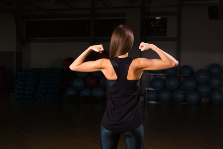Female bodybuilders muscular back flexing