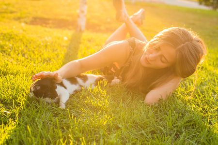 Cute Cat and Woman playing with him Outdoor Lifestyle, Friendship and Pet Owner concept