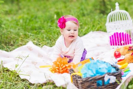 babysit: Adorable baby girl smile picnic playful weekend nature