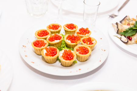 Tartlets with red caviar. Protein healthy food Stock fotó