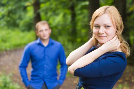 portrait beautiful young couple man woman quarreled background summer green park.