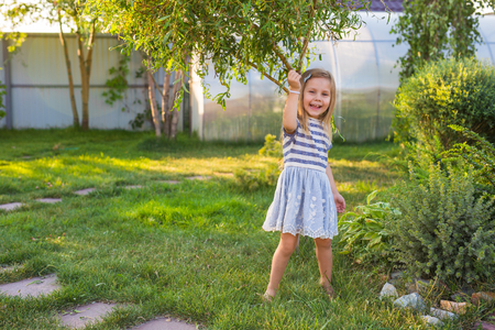 latinamerican: Portrait of sweet little girl play outdoors Stock Photo