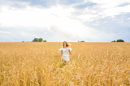 beatitude: happiness, nature, summer, autumn, vacation and people concept - young woman in the field