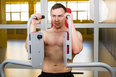 pushup: handsome bodybuilder works out excercise in gym Stock Photo