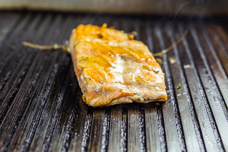 salmon roasted close up on home electronic grill plate tasty diet fish meal Stock Photo