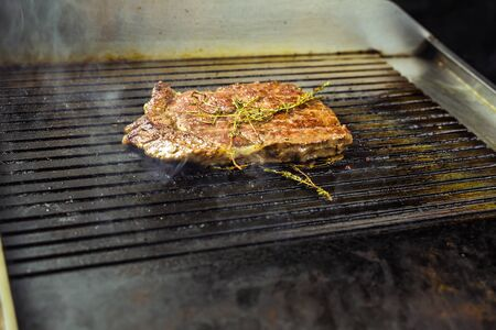 flavouring: closeup of a steak on grill