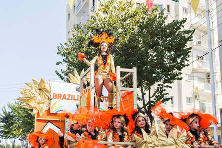 LIMASSOL, CYPRUS - FEBRUARY 26: Grand Carnival Parade - an unidentified people of all ages ,gender and nationality in colorful costumes during the street carnival, February 26, 2017 in Limassol