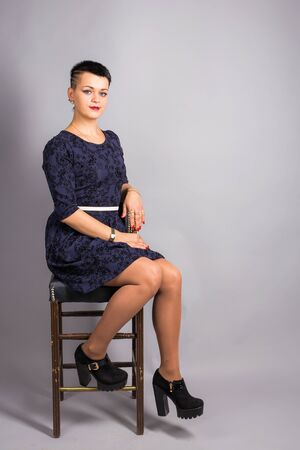 Portrait of short haired woman in blue dress Stock Photo