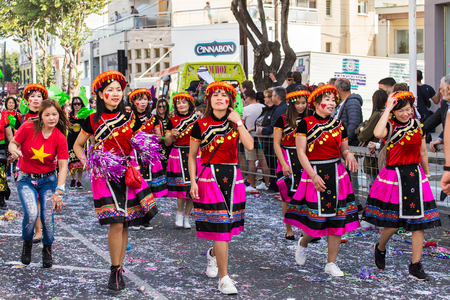 LIMASSOL, CYPRUS - FEBRUARY 26: Carnivalists in a silver cylinder hats joyfully follow the Limassol Municipality Band during the annual Carnival Parade, February 26, 2017 in Limassol
