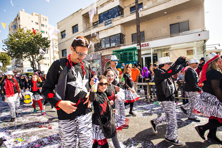 buffoon: LIMASSOL, CYPRUS - FEBRUARY 26: Happy people in teams dressed with colorfull costumes at famous Limassol Carnival Parade, February 26, 2017 in Limassol