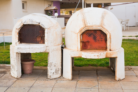 outdoor fireplace: Traditional Greece and Cyprus kleftiko pit oven. Mediterranean cuisine. Greek Lamb. Stock Photo