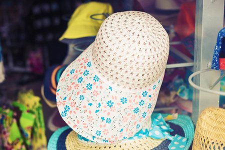 chic woman: many summer hats for sale at the market