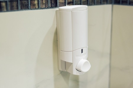 Automatic Soap Dispenser in toilet at hotel or department store, Liquid soap container