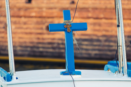 Blue wood cross. Religious and spiritual concept Stock Photo