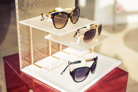 store shelf: Sunglasses Fashion display in the Shop, Hipster Lifestyle. Stock Photo