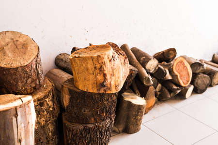 Pile of firewood. Preparation of firewood for the winter. Stock Photo
