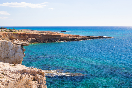 Rock cliffs and sea bay with azure water near Protaras, Cyprus island. Stock Photo
