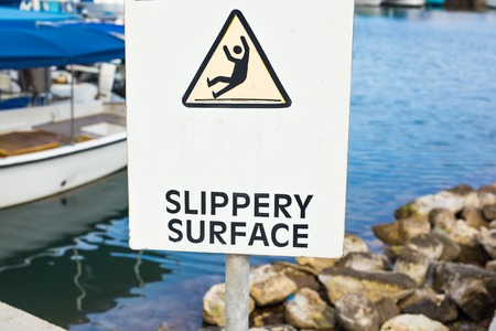 Warning: Slippery Surface sign