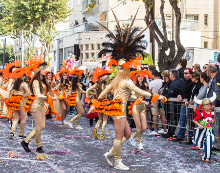 LIMASSOL, CYPRUS - FEBRUARY 26: Happy people in teams dressed with colorfull costumes at famous Limassol Carnival Parade, February 26, 2017 in Limassol