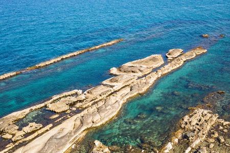Breakwater made of stones on Cyprus.