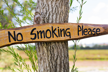 No smoking sign vintage style on wooden board Stock Photo