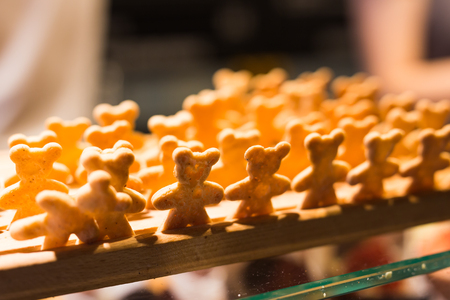 Lots of homemade little cookies in shape of bears in the bakery Stock Photo