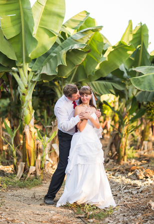 bride and groom smiling on nature Stock Photo