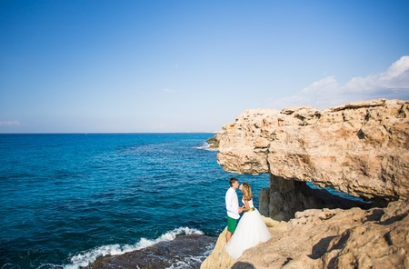 Portrait of happy bride and groom outdoor in nature location