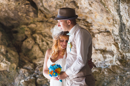 Sensual portrait of a young newlywed couple. Bride and groom outdoor Stock Photo