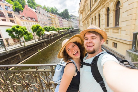 tourists couple taking selfie on city street. Vacation, love, travel and holiday concept.