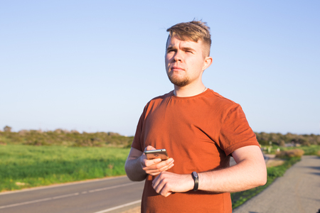 Sportsman checking his pulse on smart watch tracker Stock Photo
